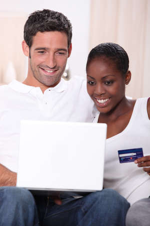 Couple with a laptop and a credit card photo