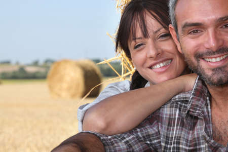 close-up of a couple in a field photo