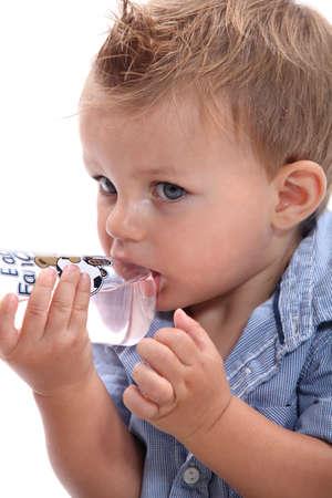 blonde close up: Boy sucking bottle