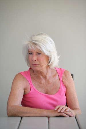 Portrait of a suspicious elderly woman Stock Photo