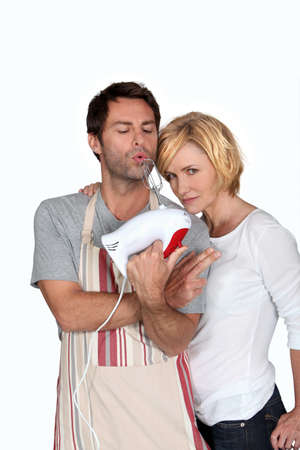 jesting: A couple jesting in kitchen