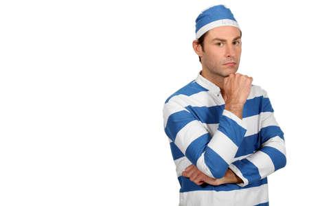 portrait of a man in prisoner costume photo
