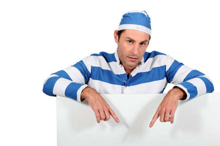 Man in a mock prisoner outfit with a board left blank for your message Stock Photo - 12005997