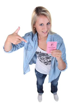 17 19 years: Teenage girl holding a French driving licence Stock Photo