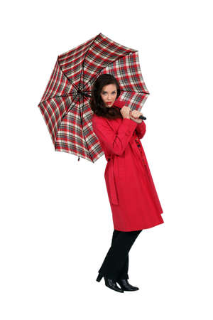 Beautiful brown-haired woman with umbrella Stock Photo - 12005433