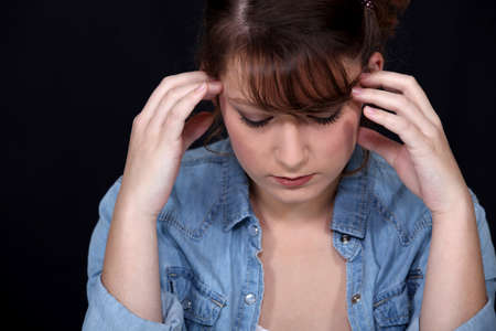 Woman suffering from a throbbing headache Stock Photo - 12006135