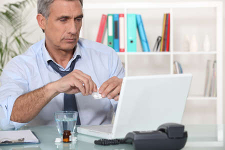 unravel: Office worker taking medication for headache