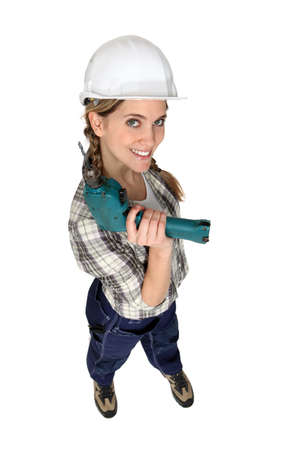 A female construction worker holding a drill. Stock Photo - 12005412