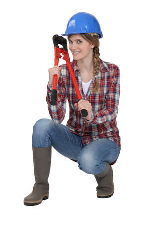 Woman holding bolt cutter whilst in crouching position Stock Photo - 12005502