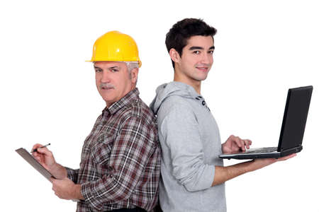 A handyman and his apprentice. photo