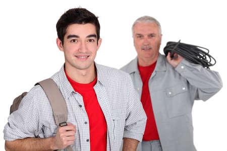 An apprentice standing near his boss Stock Photo - 12006170