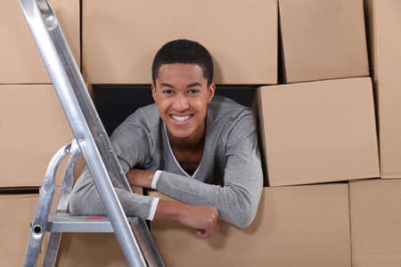 Young man on moving day photo