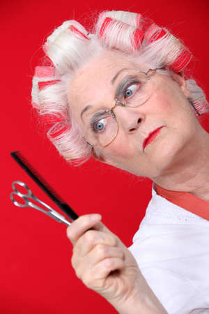 beauty shop: Old woman with her hair in rollers Stock Photo