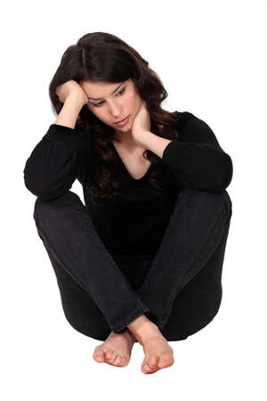 Woman with neck pain sat on floor Stock Photo - 12005456