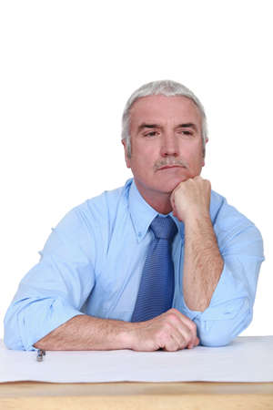 Businessman lost in thought photo