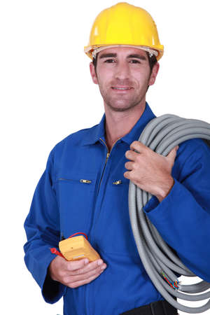 electrician: Electrician with voltmeter in hand