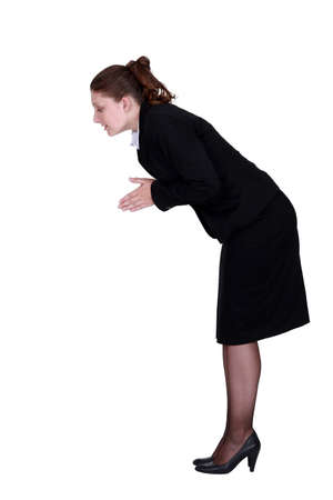 bend over: A businesswoman about to dive.