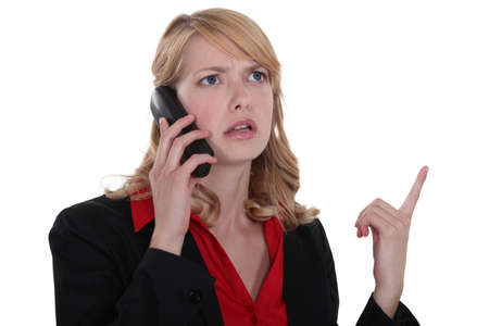 Angry blond businesswoman photo