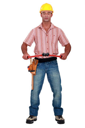 Worker with a pair of boltcutters photo