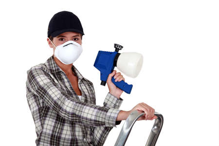 Woman holding a spray gun photo