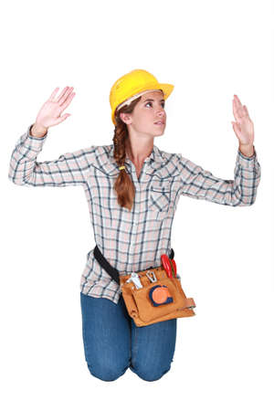 Woman kneeling with hands up photo