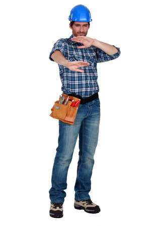 dazzled: A manual worker protection his eyes. Stock Photo