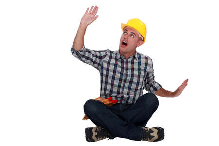 Something falling on a construction worker Stock Photo - 12005425