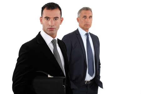 2 50: two businessmen posing