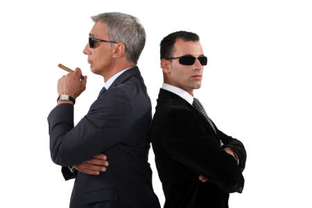 dishonest: Cocky men in smart suit Stock Photo