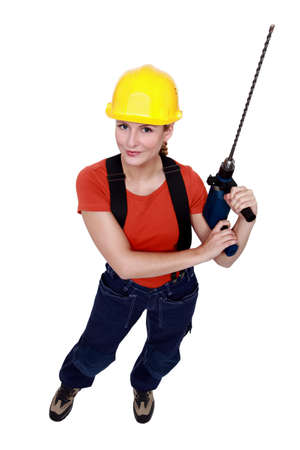 tradeswoman: Tradeswoman holding a power tool Stock Photo