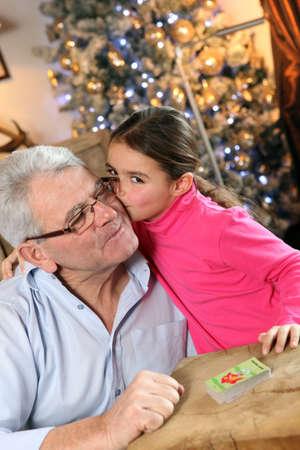 baby boomer: Grandfather and granddaughter at Christmas