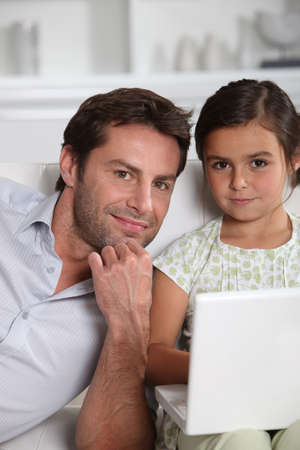 Father and daughter on laptop photo