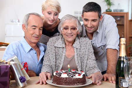 Family gathered together for birthday party photo
