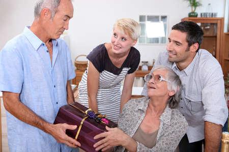 family celebrating a birthday photo