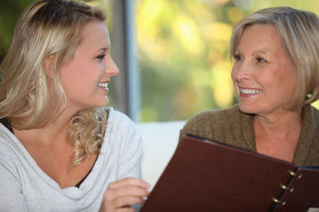 intergenerational: young woman and older woman at restaurant Stock Photo