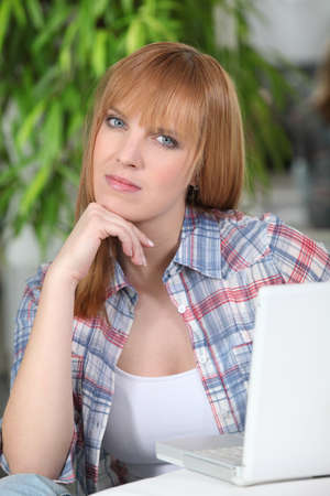 exasperate: Angry woman working on her laptop