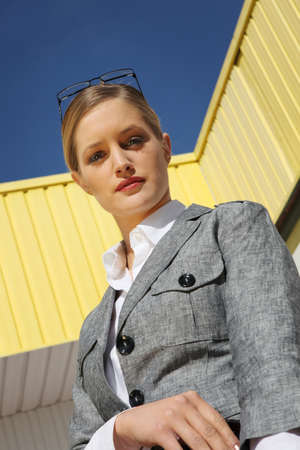 Young trendy businesswoman standing outside photo