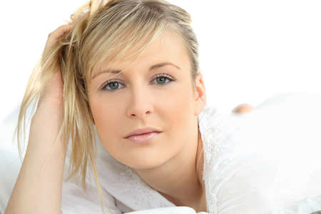 agitated: Blonde woman in bathrobe Stock Photo