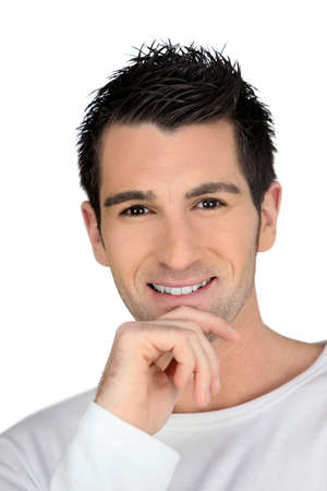 aplomb: Man smiling with his hand on his chin