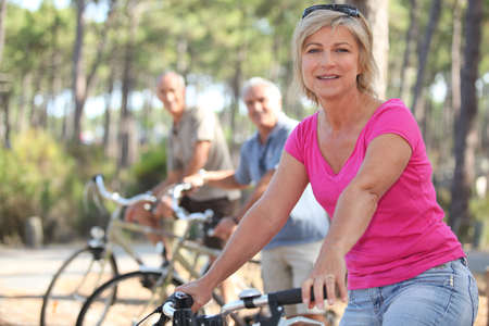 active lifestyle: group of seniors riding bikes in the park Stock Photo