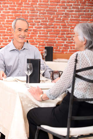 candle holders: Old couple in restaurant
