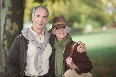 65 years old: Couple walking in the woods