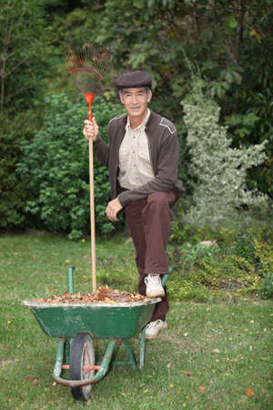 yard work: Gardener with a wheelbarrow