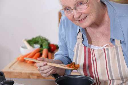 senior woman cooking photo