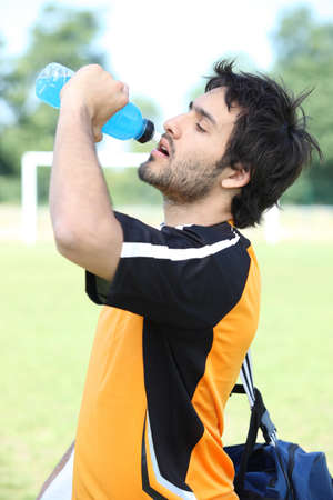 Footballer drinking water photo