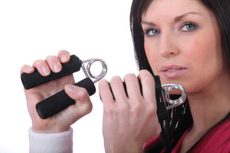 hand grip: Woman squeezing hand grippers