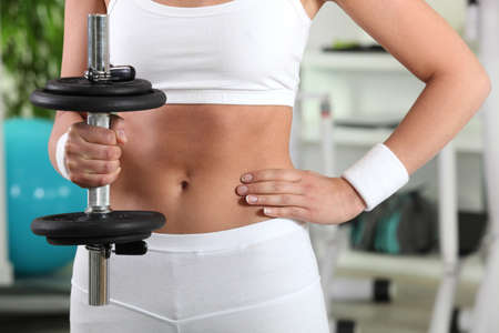 Woman in the gym lifting weights Stock Photo - 12006614