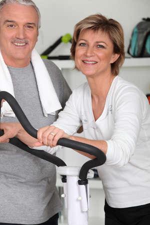 cardiovascular workout: Mature couple on treadmill Stock Photo