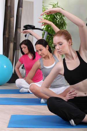 threesome: female threesome doing exercise indoors