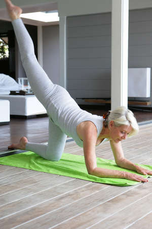 65 70 years: senior woman doing exercises Stock Photo
